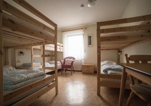 A bunk bed or bunk beds in a room at Ferienhaus Vulkaneifel Kopp