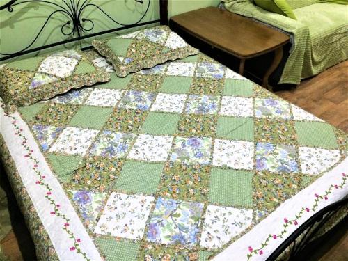 Кровать или кровати в номере Апартаменты Звенигородское Шоссе