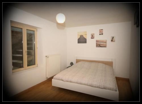 Un ou plusieurs lits dans un hébergement de l'établissement Appartements Baron Bouvier