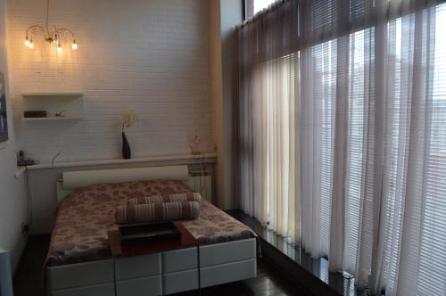 A bed or beds in a room at The Volga House Boutique-Hotel