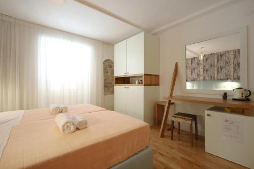 Posteľ alebo postele v izbe v ubytovaní Central Apartments Integrated Hotel