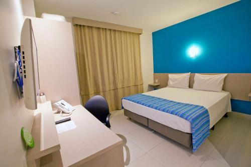 Cama ou camas em um quarto em Go Inn Hotel Aracaju