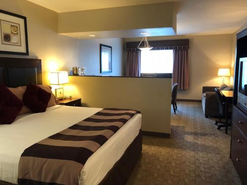 A bed or beds in a room at Shilo Inn Killeen