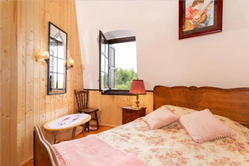 Łóżko lub łóżka w pokoju w obiekcie Windmill vacation home in Ledzin near Baltic Sea