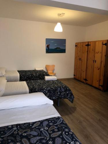 Cama o camas de una habitación en Albergue-Pensión Cabo da Vila