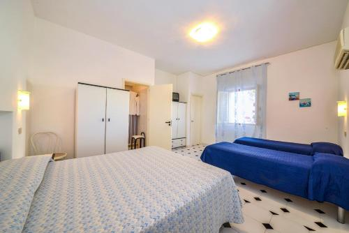 A bed or beds in a room at Albergo Godenizzo