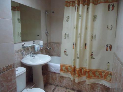 A bathroom at Galas Hotel