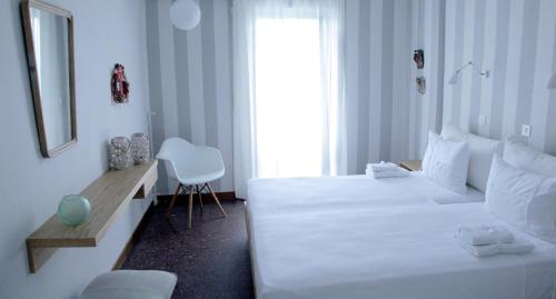 A bed or beds in a room at Liotopi