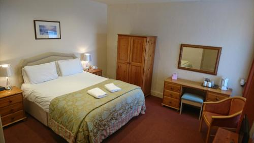 A bed or beds in a room at George & Dragon Inn