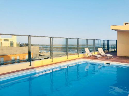 The swimming pool at or near Farol