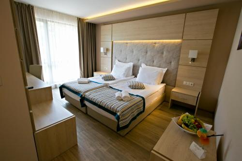 A bed or beds in a room at Royal Grand Hotel and Spa - All Inclusive