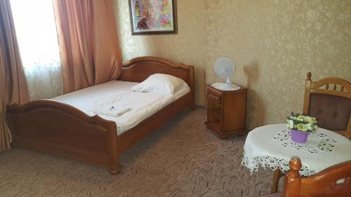 A bed or beds in a room at Hotel Kotva