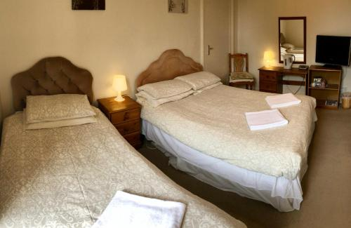 A bed or beds in a room at Errolbank Guest House