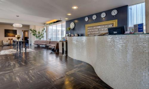 The lobby or reception area at Best Western Plus Hotel Farnese