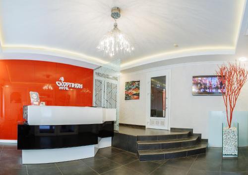 Лобби или стойка регистрации в Отель Скорпион
