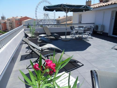 Balcon ou terrasse dans l'établissement Brit Hotel Opal Centre Port
