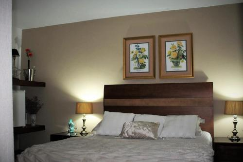 A bed or beds in a room at Match Point Spa