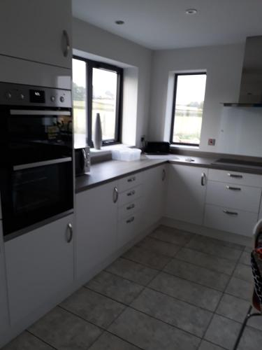 A kitchen or kitchenette at Foxholes Accommodation