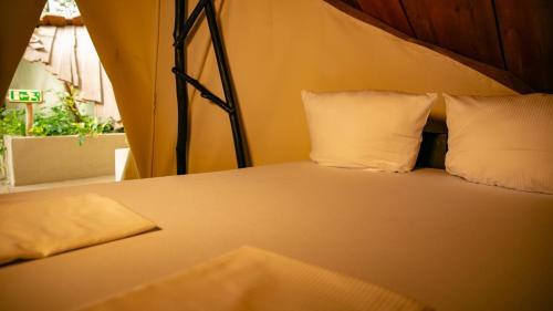 Ein Bett oder Betten in einem Zimmer der Unterkunft Tropical Islands