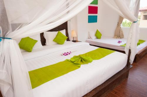 A bed or beds in a room at Suite Home Boutique Hotel
