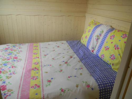 A bed or beds in a room at Chambres d'hôtes La Prairie