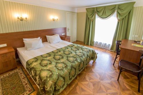 Кровать или кровати в номере Гостиница Московская Застава
