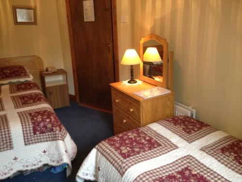 A bed or beds in a room at Ballyglass Country House