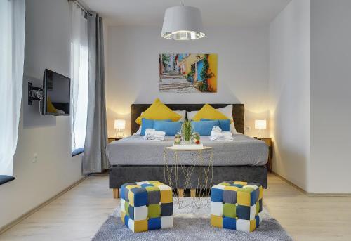 Cama o camas de una habitación en D&A Amphitheatre Apartments