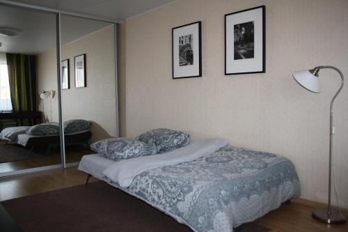 A bed or beds in a room at Apartment on Gogolya 11