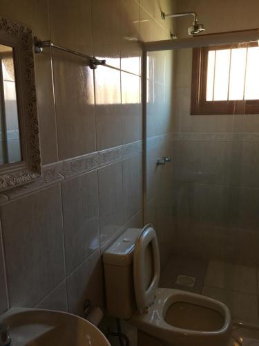 Um banheiro em Apartamento Altreider
