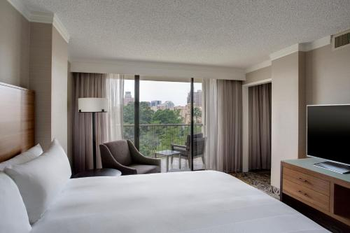 A bed or beds in a room at San Antonio Marriott Riverwalk