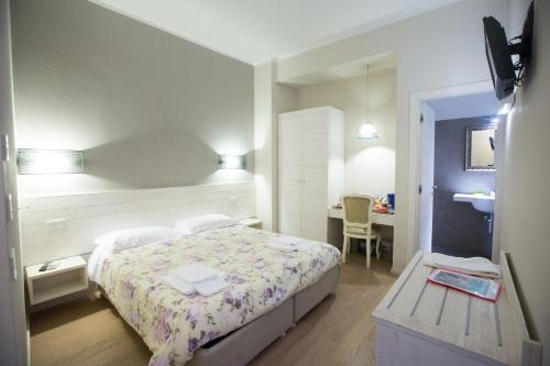 A bed or beds in a room at Alla Marina Affittacamere