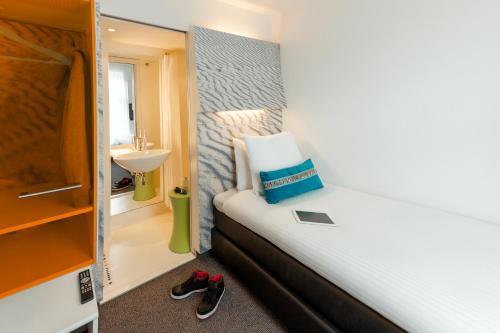 Ein Badezimmer in der Unterkunft ibis Styles Amsterdam Central Station