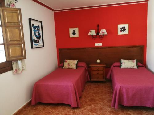 Cama o camas de una habitación en Hostal Maestre