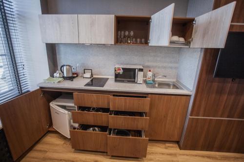 Кухня или мини-кухня в Отель «Далиси»