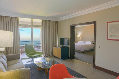 A seating area at Portemilio Hotel & Resort