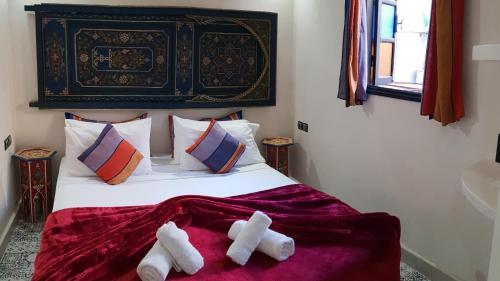 Ein Bett oder Betten in einem Zimmer der Unterkunft Riad Africa