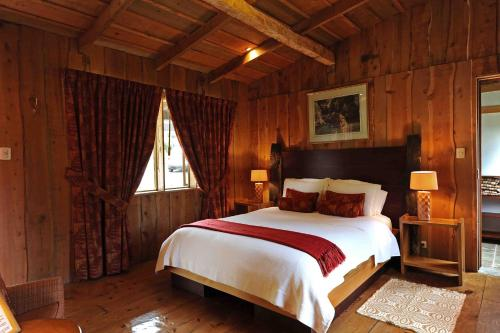 A bed or beds in a room at Poas Volcano Lodge
