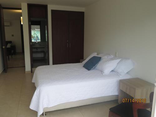 Cama ou camas em um quarto em Tamarindo Centro Vip Apartment