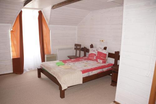 Кровать или кровати в номере Hotel Kazachy Stan