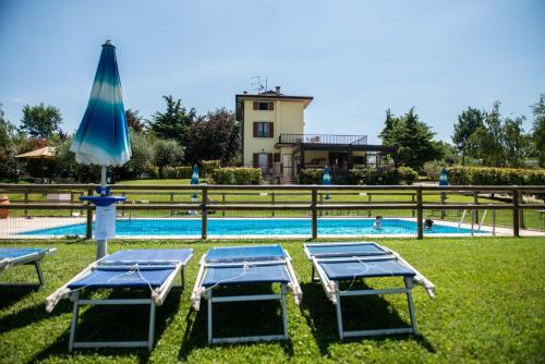 The swimming pool at or close to Agriturismo Il Giardino Degli Ulivi