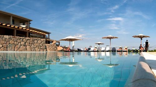 The swimming pool at or near Hotel Villa Gustui Maris