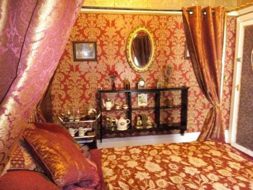 A bed or beds in a room at Caspians Boutique Guesthouse