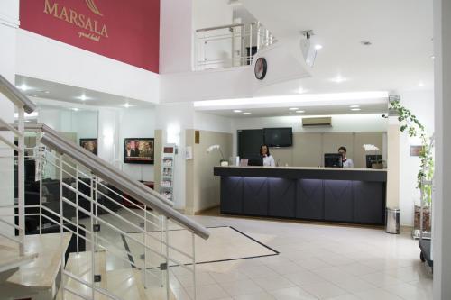 The lobby or reception area at Marsala Apart Hotel