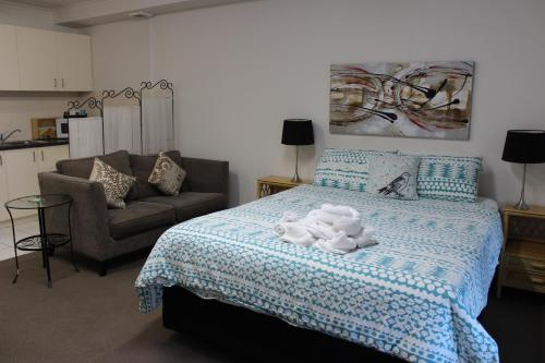 A bed or beds in a room at Box Hill Studio Apartment 2