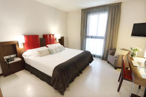 A bed or beds in a room at Ciutat de Girona