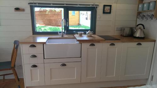 A kitchen or kitchenette at Orchard Farm Luxury Glamping