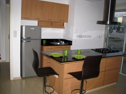 A kitchen or kitchenette at Nicosia Suites