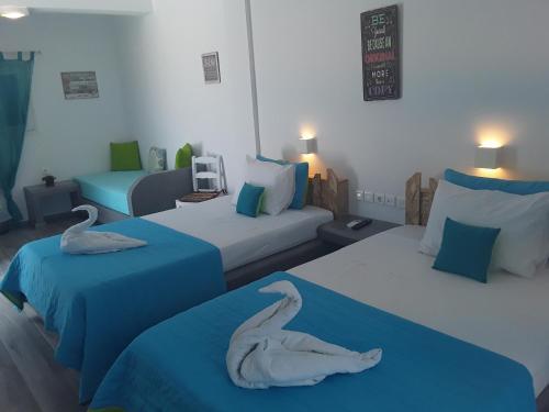 Letto o letti in una camera di Azalea Hotel