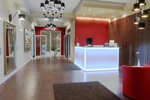 The lobby or reception area at Hotel Ajax